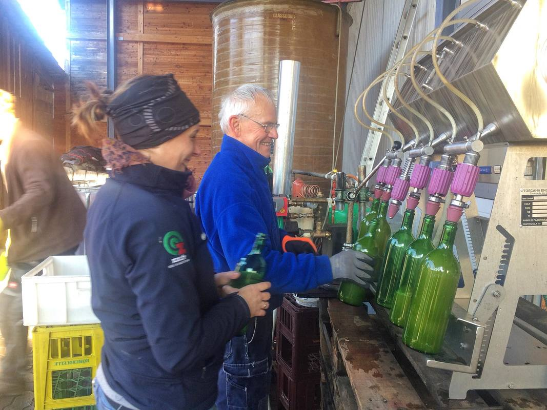 Bottling apple juice on Maria's farm